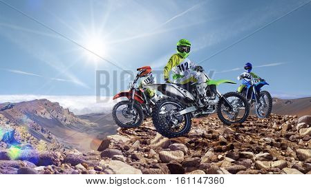 Brave professional dirt bike riders on the top of vulcan