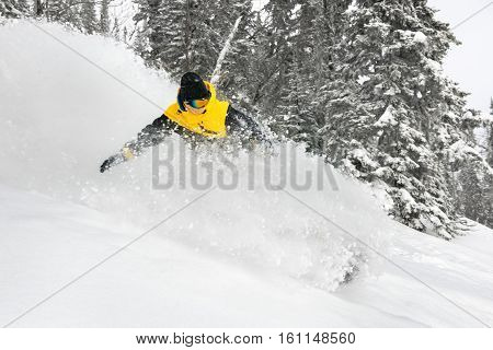 Skier downhill very fast. Extreeme backcountry riding. Sheregesh ski resort