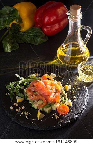 Tartare Of Salmon And Avocado. Fresh Salad On Stone Slate
