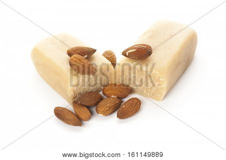 block of marzipan with almonds isolated on white background