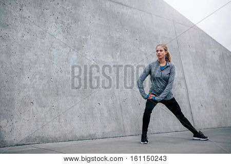 Young Sports Woman Exercising Outdoors