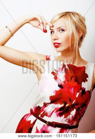young pretty blonde girl presenting something at white copy space, emotional posing, lifestyle people concept close up