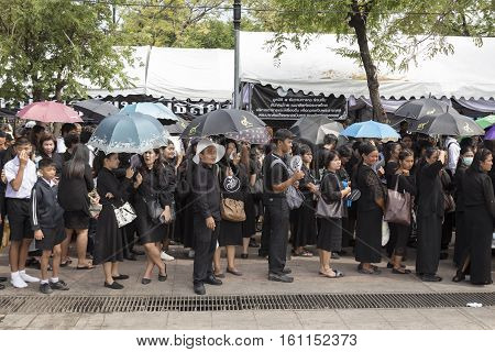 BANGKOK THAILAND - NOV 5 : mourners with umbrella in sanam luang for queue into Grand Palace while the funeral of king Bhumibol Adulyadej on november 5 2016