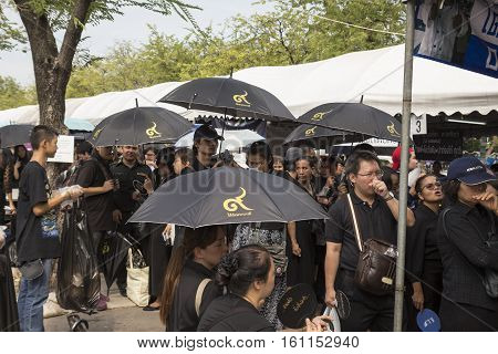 BANGKOK THAILAND - NOV 5 : The crowd with umbrella in sanam luang for queue into Grand Palace while the funeral of king Bhumibol Adulyadej on november 5 2016