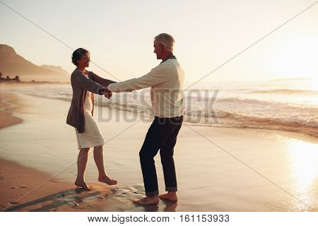 Romantic Senior Couple Enjoying A Day At The Beach