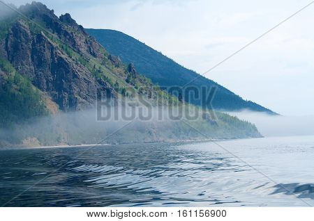Fog on the Baikal sunrise spring, Russia