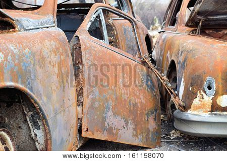 Vintage classic cars with rust taken in a rural countryside junkyard