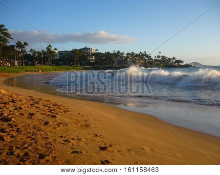 beach view with ocean waves crashing as tide comes in