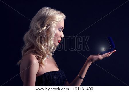 Beautiful blond woman with a box of jewelry.