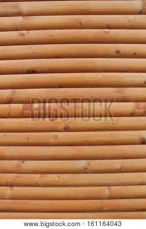 Blockhouse wooden brown wall close-up texture and background
