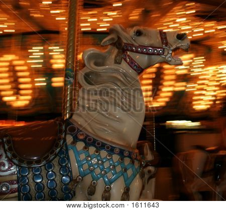 an action shot of a horse on a merry-go-round poster