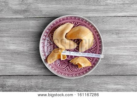 Plate with fortune cookies  on wooden background