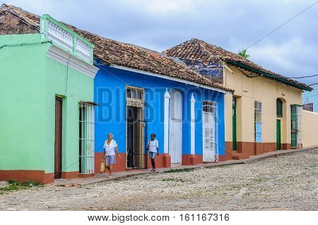 TRINIDAD, CUBA - MARCH 23, 2016: Blue house with white windows on the cobblestone streets in the UNESCO World Heritage old town of Trinidad Cuba