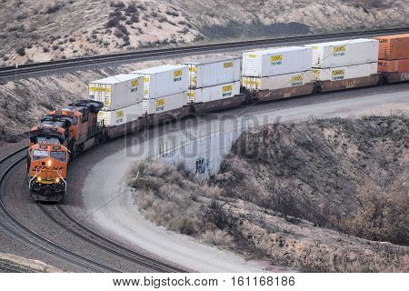 December 11, 2016 in Cajon, CA:  BNSF Freight Train traveling southbound towards Los Angeles transporting commerce to Southern California and beyond taken in the Cajon Pass, CA where train enthusiasts can get non obstructing views of trains