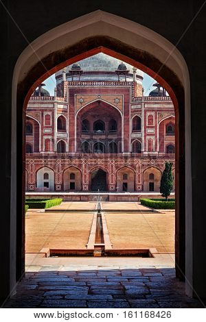 Delhi Indian tourist landmark Humayun's Tomb view through arch. Delhi, India