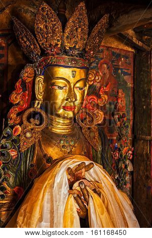 Maitreya Buddha statue close up Tibetan monastery Thiksey Gompa. Ladakh, Jammu and Kashmir, India