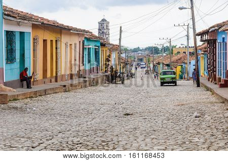 TRINIDAD, CUBA - MARCH 23, 2016: Daily scenery on the cobblestone streets in the UNESCO World Heritage old town of Trinidad Cuba