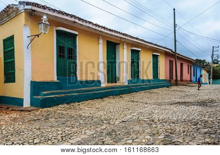 TRINIDAD, CUBA - MARCH 23, 2016: Kid walking on the cobblestone streets in the UNESCO World Heritage old town of Trinidad Cuba