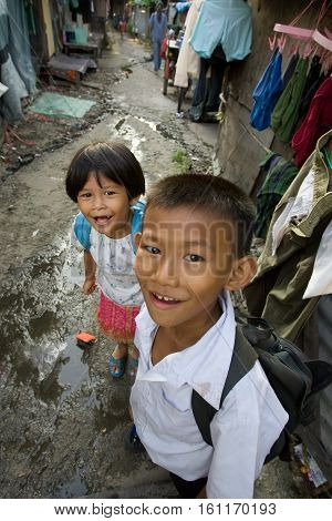Bangkok , Thailand - July 26, 2006:  young children living in a slum. There are an estimated 7.3 million people that are considered to be in poverty in Bangkok, Thailand.