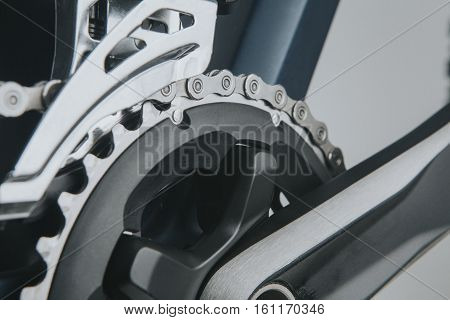 Detailed view of bike crankset and chain.