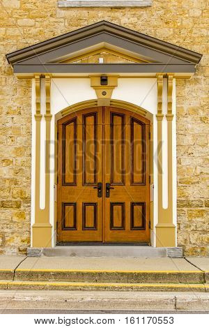 A beautiful wooden doorway into an old church in a small rural Wisconsin town.