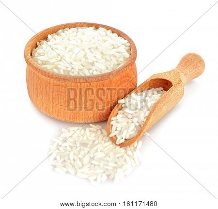 Long grain rice in wooden bowl and scoop on white background
