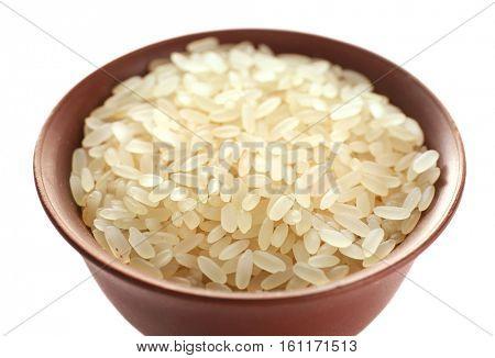 Parboiled long grain rice in cup closeup