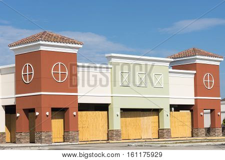 Construction of a colorful commercial building boarded up to keep the public from harm