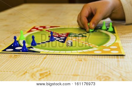 Colorful board for playing traditional children's game closeup