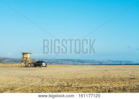 lifeguard tower and police truck in Newport Beach California