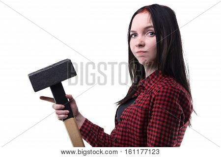 Puzzled young brunette with big hammer on white background