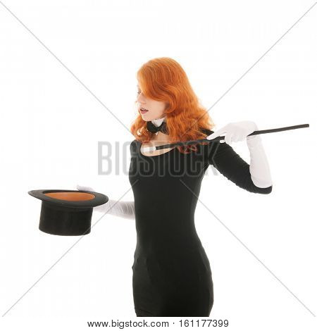 Woman conjuring with silk black hat