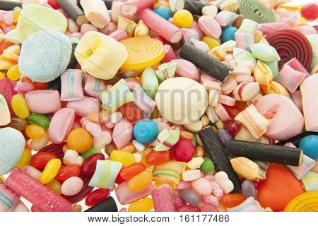 Mixed colorful sweet candy as background