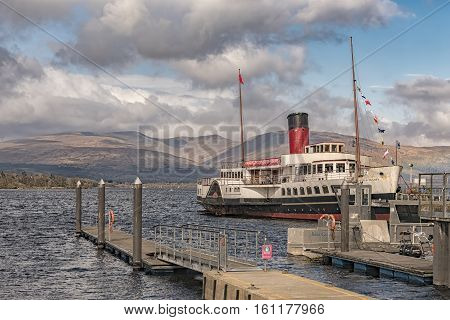 LOCH LOMOND SCOTLAND - APRIL 05: The paddle steamer 'Maid of the Loch' has just been fully restored for operation on the beautiful Scottish Loch Lomond Scotland on April 05 2016.