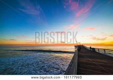 Wooden pier in Pacific Beach at sunset California