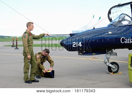 WINDSOR, CANADA - SEPT 10, 2016: View of canadian military Jet and pilots in exhibit at the Windsor Aviation Museum.