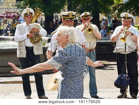 31.07.2016 .Russia.Saint-Petersburg.The orchestra plays.Grandma dancing to the music.