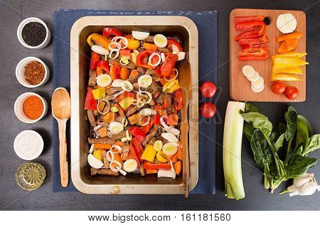 Cooking Baked Meat With Vegetables In Casserole Dish