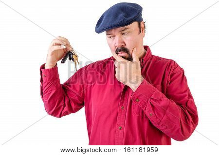 Confused Man Frowning At A Bunch Of Car Keys