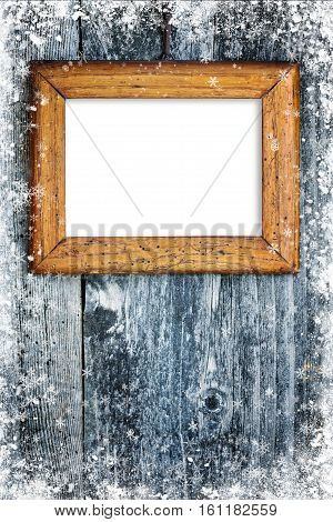 Old frame on snowbound wooden background for your text or image