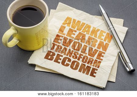 awaken, learn, evolve, transform and become - inspirational word abstract on a napkin with a cup of tea