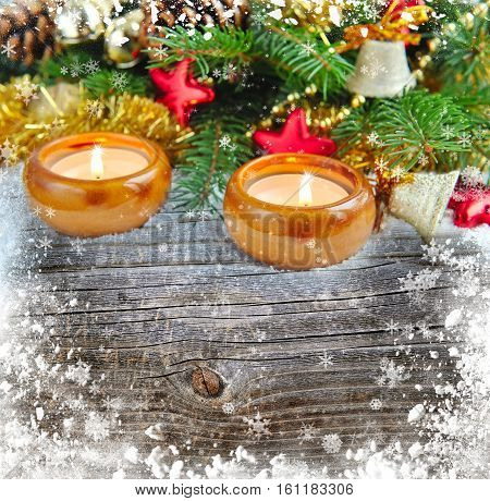 Christmas Composition Is With Candles On A Snowbound Wooden Background