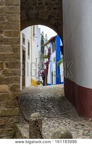 The street of Obidos in Portugal popular tourist destination because of its a well-preserved medieval architecture