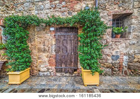 quaint corner with wooden bench in Monteriggioni Italy