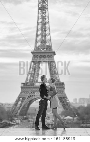 Young Romantic Couple Near The Eiffel Tower In Paris