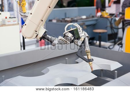 Automated welding. Industrial robotic arm for welding.