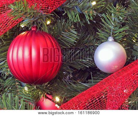 Assorted Christmas Ornaments on a Christmas Tree.
