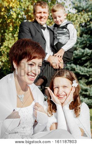 Happy family at the wedding. Mom dad son and daughter. Family values