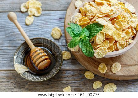 Corn Flakes Coated With Honey And A Sprig Of Mint.