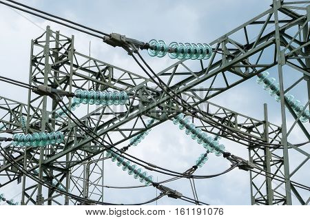 Electricity distribution. Elements of electrical pylon - insulators, cables and fasteners.